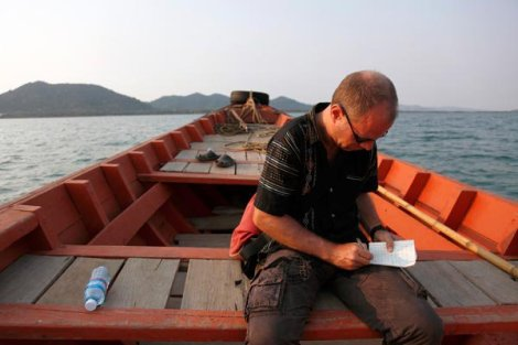 Ko Tonsay: At work for the Asia Wall Street Journal going near Kep in Cambodia. Photo by Luke Duggleby