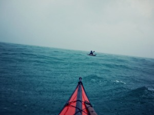 Tim paddling in a squall