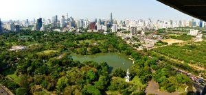 Bangkok's skyline from Rama IV Road, with Lumphini Park in the foreground