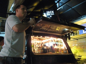 Scott Coates drinking at a VW Van Bar: Chiang Mai on Talk Travel Asia podcast