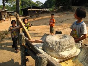 Hill Tribe Children Griding Corn: Talk Travel Asia podcast