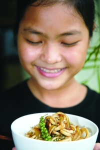 Student with Food from Training Restaurant - courtesy Friends International