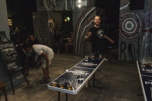 Trevor playing Ping Pong in Bar Games Olympics on Talk Travel Asia Podcast